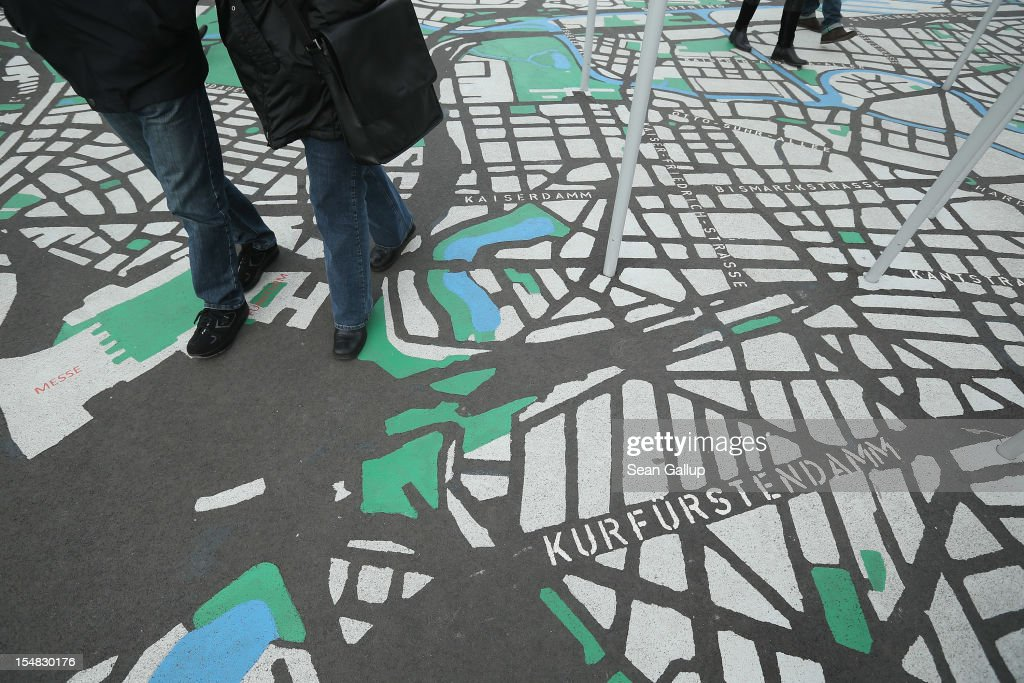 Visitors walk across a painted map of Berlin in 1:775 scale during celebrations marking the 775th anniversary of the city of Berlin on October 27, 2012 in Berlin, Germany. Celebrations are continuing over the weekend and will culminate in a fire presentation by the French fire performers Carabosse on Sunday. The settlement of Coelln, which stood opposite Berlin on the Spree river, is first referred to in a document from 1237, and by the beginning of the 14th century Coelln and Berlin joined together to become the region's most important trading center.