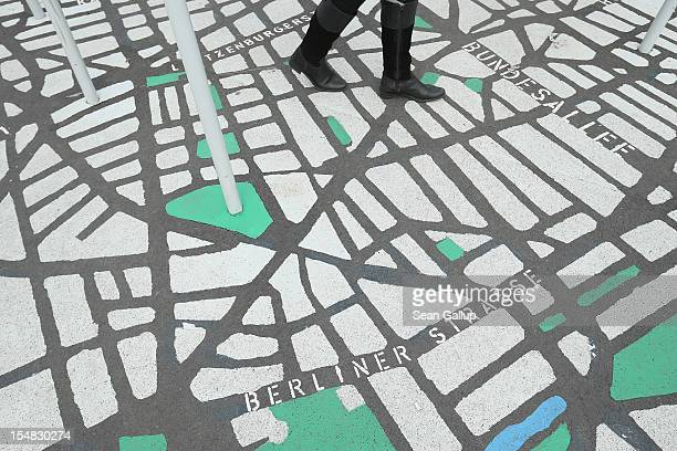 Visitors walk across a painted map of Berlin in 1775 scale during celebrations marking the 775th anniversary of the city of Berlin on October 27 2012...