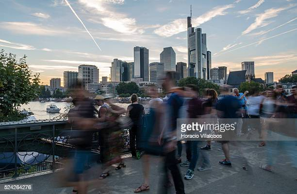 Visitors walk across the Eiserner Steg over the Main River during the Museum Embankment Festival in Frankfurt Germany 29 August 2015 The Museum...