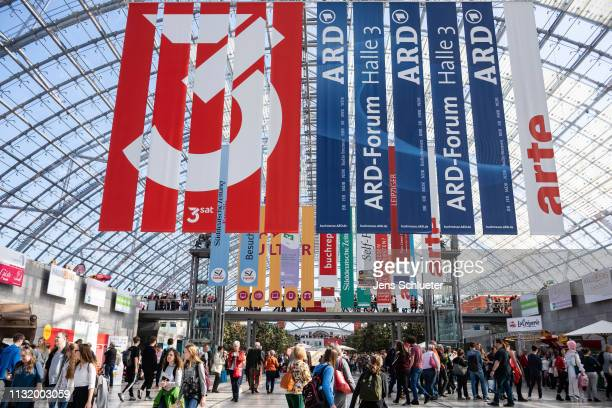 Visitors walk across the fairgrounds at the 2019 Leipzig Book Fair on March 22 2019 in Leipzig Germany The 2019 Leipzig Book Fair is open to the...