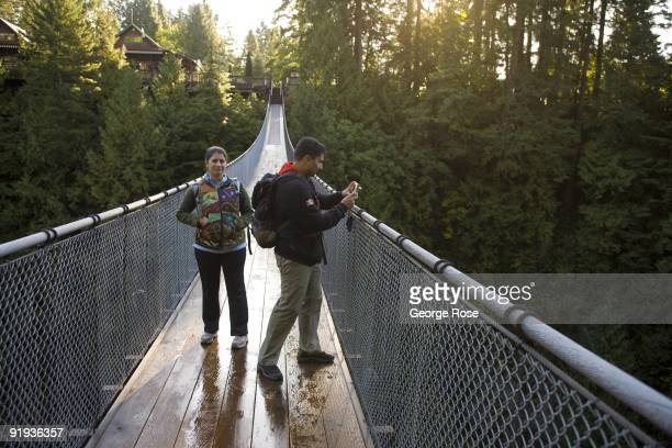 Visitors walk across the famed Capilano Suspension Bridge as seen in this 2009 Vancouver British Columbia Canada cityscape photo This West Coast...