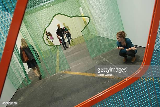 "Visitors walk among an installtion piece by Daniel Steegmann Mangrane at the ""art berlin contemporary"" art trade fair at The Station on September 20,..."