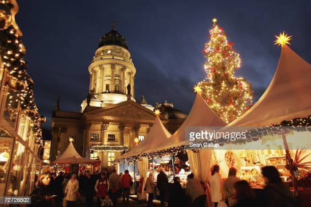Visitors walk among booths at the Christmas market at Gendarmenmarkt December 5 2006 in Berlin Germany Christmas markets are the highlight of the...