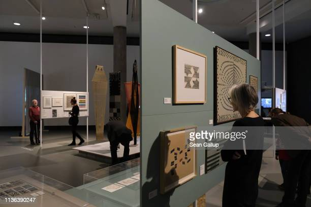 Visitors walk among exhibits in the 'Learning From' portion at the 'Bauhaus Imaginista' exhibition at the Haus der Kulturen der Welt on March 17 2019...