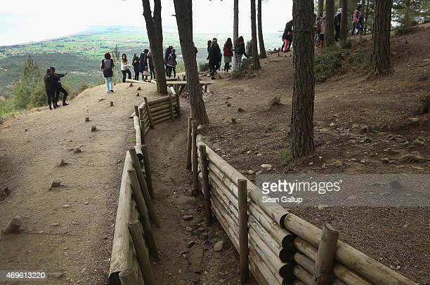 Visitors walk among recreated Turkish trenches from the Gallipoli campaign at Chunuk Bair on April 7, 2015 near Eceabat, Turkey. Allied and Turkish...