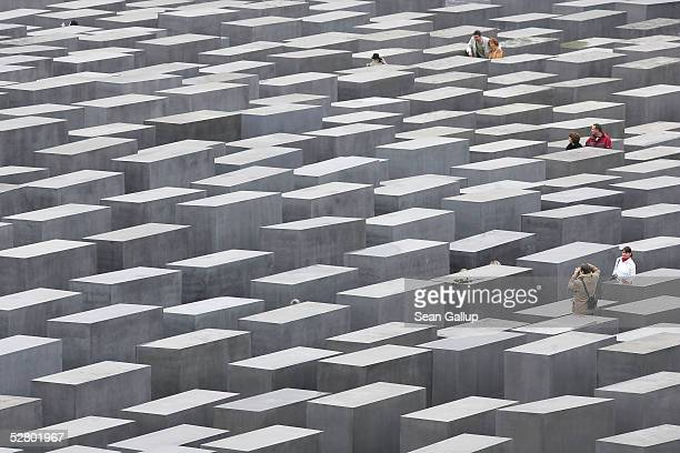 Visitors walk among some of the 2,711 stellae of a Holocaust memorial on the first day of its opening to the public May 12, 2005 in Berlin, Germany....