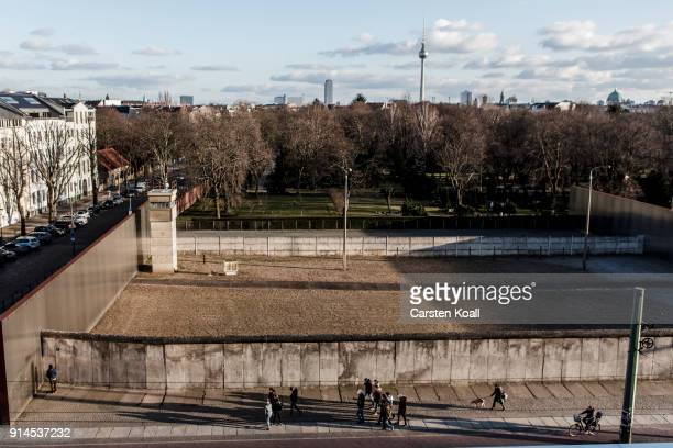 Visitors walk among the Berlin Wall memorial at Bernauer Strasse on February 5 2018 in Berlin Germany Today has been 10316 days since the Berlin Wall...