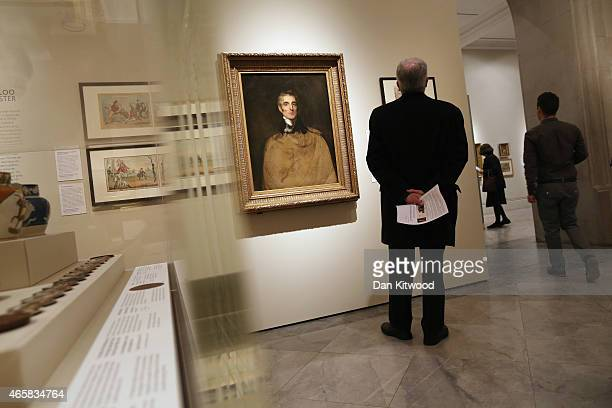 Visitors walk around during a press preview, 'Wellington: Triumps, Politics and Passions', at the National Portrait Gallery on March 11, 2015 in...