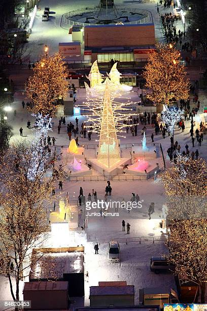 Visitors walk around exhibits at the 60th Sapporo Snow Festival ahead of its opening at Odori Park on February 4 2009 in Sapporo Japan The festival...