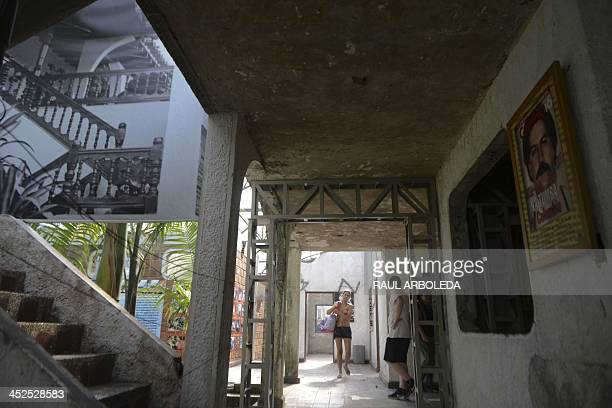 Visitors walk at Colombian drug trafficker Pablo Escobar's damaged mansion at the Napoles Ranch theme park in the Puerto Triunfo municipality...