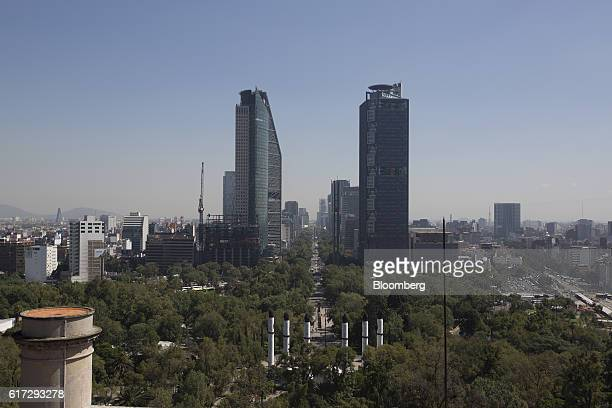 Visitors walk between the Altar of the Homeland and Avenue of the Reform inside the first section of Chapultepec Park in Mexico City Mexico on Friday...