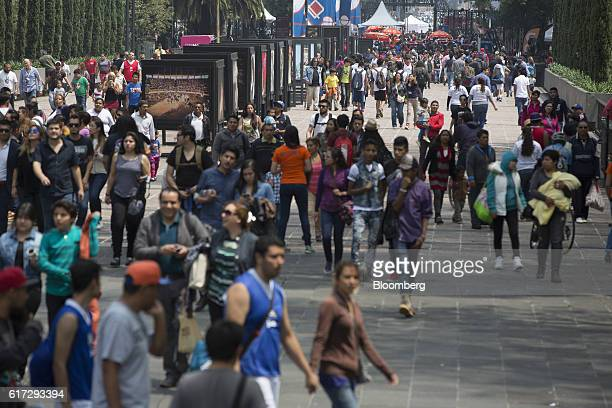 Visitors walk between the Avenue of the Reform and the Altar of the Homeland inside the first section of Chapultepec Park in Mexico City Mexico on...