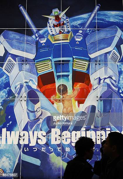 Visitors walk by a display for the popular Japanese anime 'Gundam' during the Tokyo International Anime Fair 2009 at Tokyo Big Sight on March 18 2009...