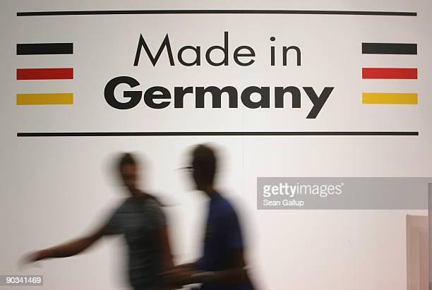 Visitors walk by a Made in Germany sign at the IFA technology trade fair on September 4 2009 in Berlin Germany The IFA fair is open to the public...