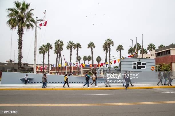 Visitors walk by a submarine replica during the Velas Latinoamerica 2018 Nautical Festival at Callao Naval Base on June 21 2018 in Callao Peru The...