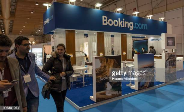 Visitors walk by 'Bookingcom' stand at BTL 'Bolsa de Turismo Lisboa' trade fair on March 02 2018 in Lisbon Portugal BTL is the benchmark for the...