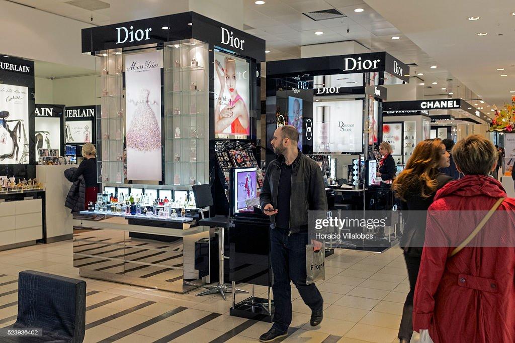 Visitors walk by Dior stand in de Bijenkorf department store