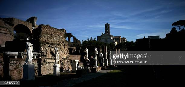 Visitors walk by statues of Vestals at the House of the Vestal virgins during the inauguration of a new itinerary going from Via Nova to the Roman...
