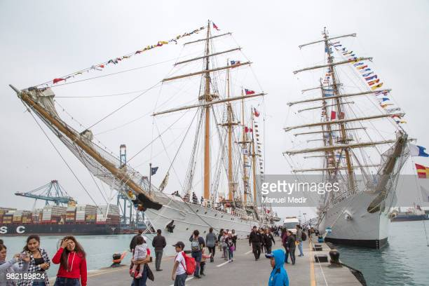 Visitors walk by the Esmeralda of Chile and the Libertad of Argentina during the Velas Latinoamerica 2018 Nautical Festival at Callao Naval Base on...