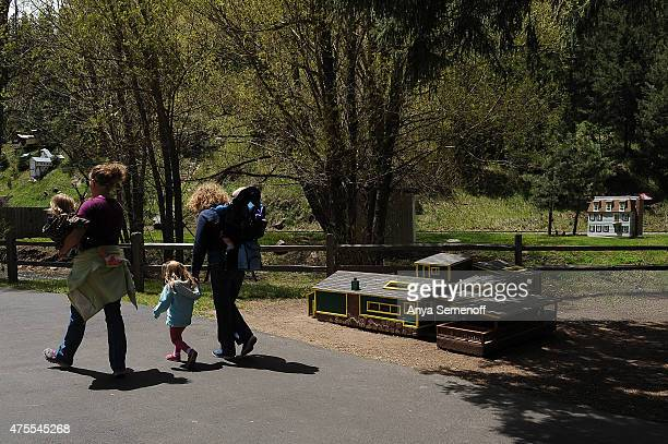 Visitors walk by the new Sit-N-Bull Saloon model at Tiny Town on May 26 in Jefferson County, Colorado. Tiny Town & Railroad originally opened in...