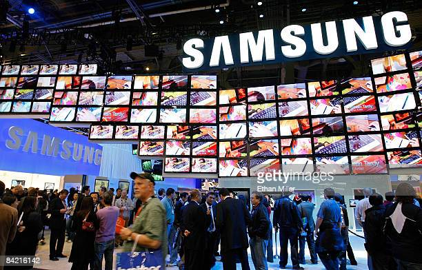 Visitors walk by the Samsung booth at the 2009 International Consumer Electronics Show at the Las Vegas Convention Center January 8 2009 in Las Vegas...