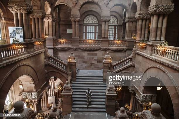 A visitors walk down the Million Dollar Staircase at the New York State Capitol building in Albany New York US on Wednesday May 22 2019 New York...