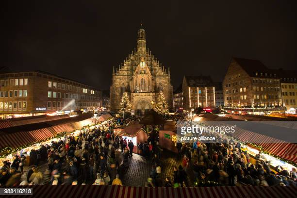 Visitors walk in between the market stands after the offical opening of the Christmas market in Nuremberg Germany 01 December 2017 Photo Daniel...