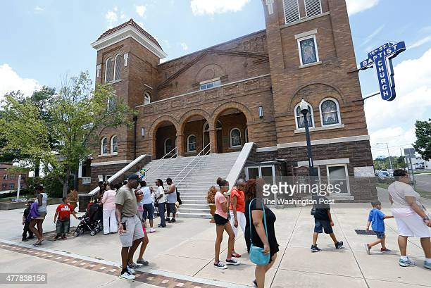 Visitors walk in front of the Sixteenth Street Baptist Church Friday June 19 in Birmingham Ala