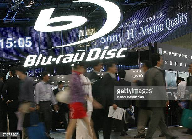 Visitors walk in front of the Sony Corp's new products Bluray Disc systems booth during the CEATEC Japan 2006 exhibition at Makuhari Messeon on...