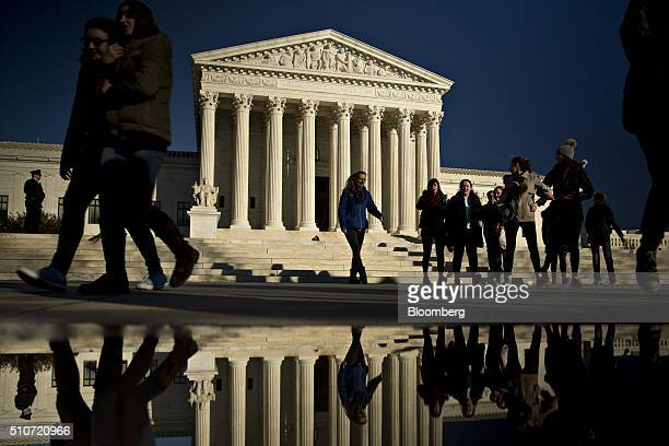 Visitors walk in front of the US Supreme Court building in Washington DC US on Tuesday Feb 16 2016 Justice Antonin Scalia's unexpected death and...