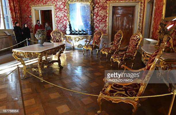 Visitors walk in the audience room of the Imperial apartments of the Royal Palace on December 3 2012 at the Correr museum in VeniceThe rooms reserved...