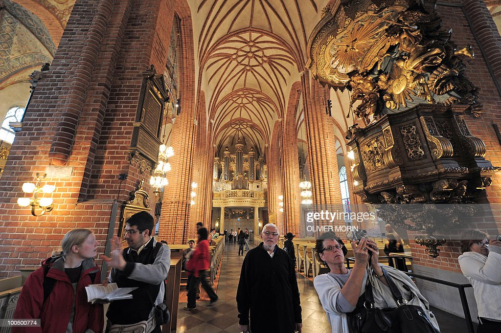 Visitors walk in the Cathedral, known as Storkyrkan, situated near the Royal Castle in Stockholm on May 25, 2010, less than a month before Crown Princess Victoria 's wedding, the 32-year-old eldest daughter of King Carl XVI Gustaf. Tensions with the archbishop, the future prince's health problems and the soaring cost of the festivities are just some of the controversies surrounding the run-up to Swedish Crown Princess Victoria and her husband-to-be Daniel Westling's June 19 wedding.