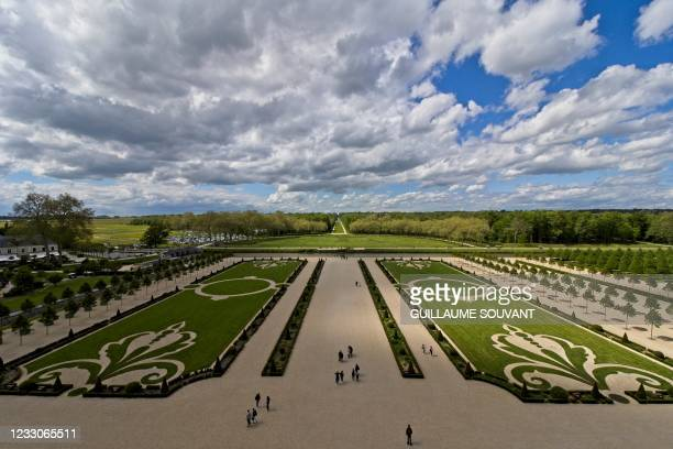 Visitors walk in the French garden of the Chambord's castle, on May 23 in Chambord, central France as France eases-up the measures adopted to curb...