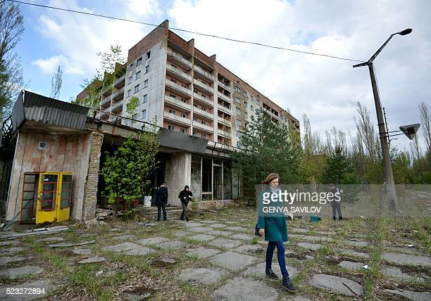 Visitors walk in the ghost town of Pripyat near the Chernobyl Nuclear Power Plant on April 22 2016 April 26 2016 marks the 30th anniversary of the...