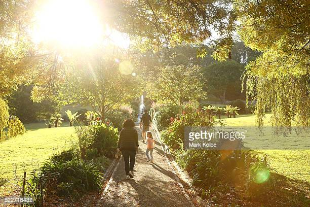 Visitors walk in the Government Gardens of the Port Arthur Historical Site on April 18 2016 in Port Arthur Australia The historic town became...
