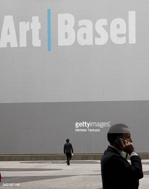 Visitors walk in the main Hall during the press preview for Art Basel at Basel Messe on June 14 2016 in Basel Switzerland