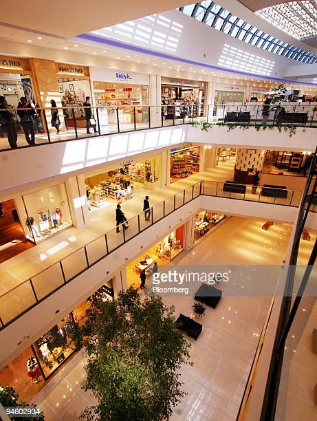 Visitors walk in the Mitsui Fudosan Co's LaLaport Yokohama in Kanagawa prefecture Japan on Monday March 12 2007 The Topix real estate index dropped...