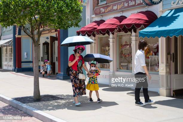 Visitors walk in Walt Disney Co's Disneyland Resort on June 18 2020 in Hong Kong China