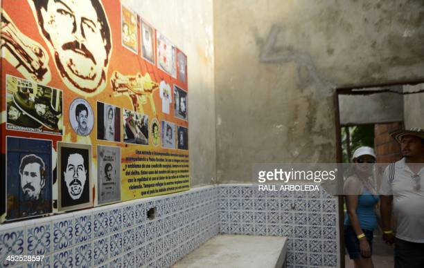 Visitors walk inside Colombian drug trafficker Pablo Escobar's damaged mansion at the Napoles Ranch theme park in the Puerto Triunfo municipality,...