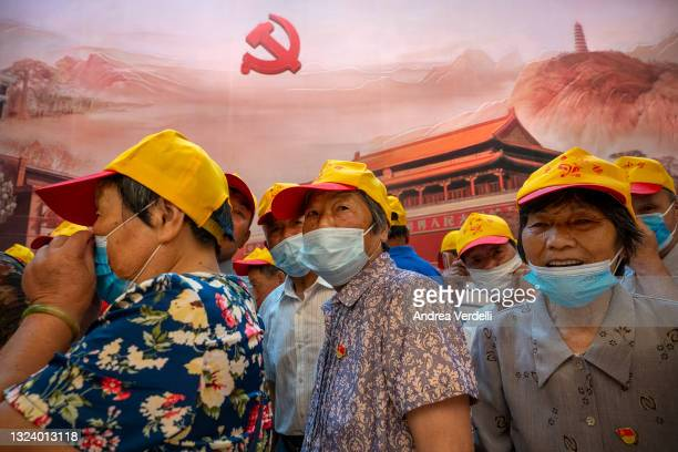 Visitors walk inside of the Memorial of the First National Congress of the Communist Party of China, on June 17, 2021 in Shanghai, China. The...