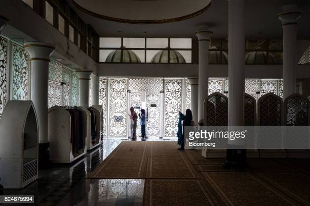 Visitors walk inside the Crystal Mosque in Kuala Terengganu Terengganu Malaysia on Monday July 23 2017 With a federal election due within 12 months...