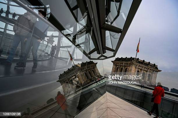 Visitors walk inside the glass dome of the Reichstag building, which houses Germany's bundestag lower house of parliament, in Berlin November 1,...