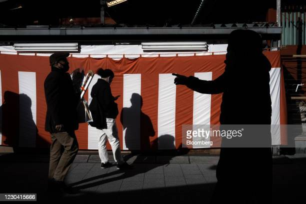 Visitors walk inside the Kanda Myojin shrine on the first business day of the year in Tokyo, Japan, on Monday, Jan. 4, 2021. Japanese stocks declined...
