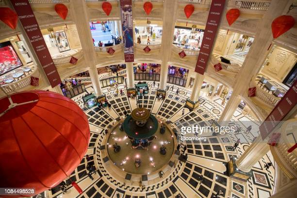 Visitors walk inside the Parisian Macao casino resort operated by Sands China Ltd a unit of Las Vegas Sands Corp in Macau China on Thursday Jan 17...