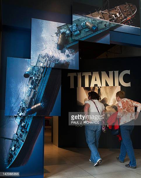 Visitors walk into National Geographic's 'Titanic 100 Year Obsession' on the first day it is opened to the public on March 29 in Washington DCThe...