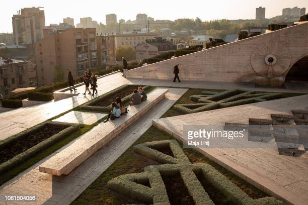 Visitors walk near Cafesjian Center for the Arts Housed in a vast flight of stone steps known as the Cascade, on November 13, 2018 in Yerevan,...