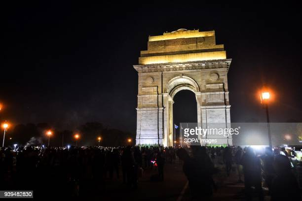 Visitors walk near the India Gate at night in New Delhi India India Gate was built in the memory of more than 90000 Indian soldiers who lost their...