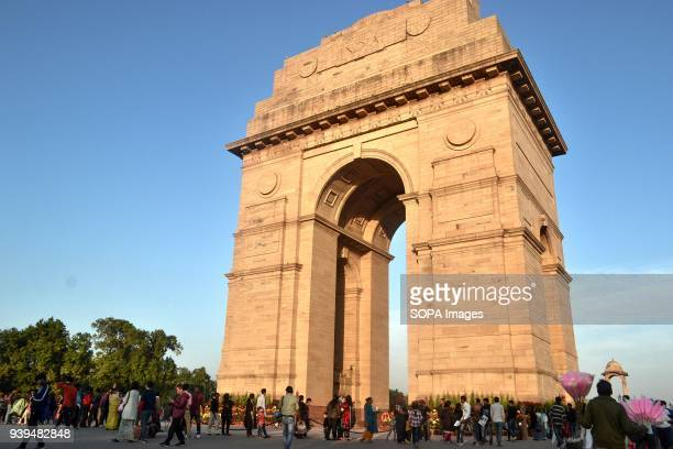 Visitors walk near the India Gate in New Delhi India India Gate was built in the memory of more than 90000 Indian soldiers who lost their lives...
