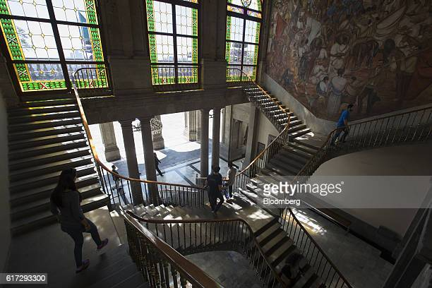 Visitors walk on a staircase inside the Chapultepec Castle which houses Mexico's National Museum of History in Mexico City Mexico on Friday Oct 14...