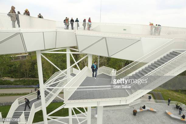 Visitors walk on a viewing platform at the IGA 2017 international garden exhibition on April 28 2017 in Berlin Germany The IGA includes horticultural...